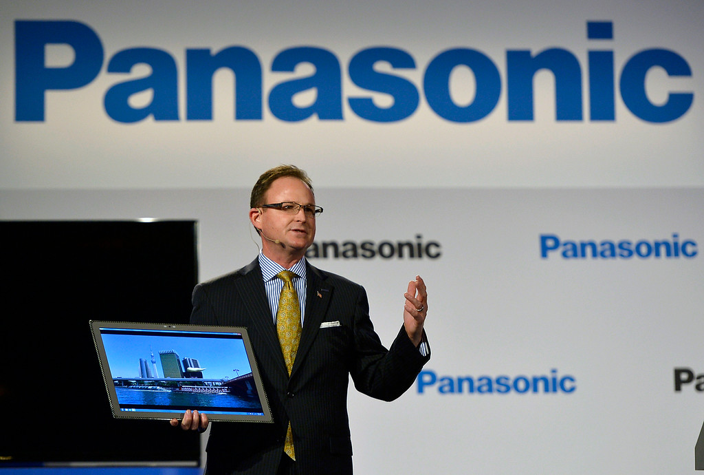 ". Rance Poehler, president of Panasonic Company of North America, shows off the new 20"" tablet during the Panasonic news conference at the 2014 International Consumer Electronics Show Monday, Jan. 6, 2014, in Las Vegas. (AP Photo/Jack Dempsey)"