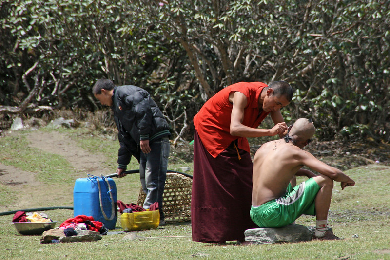 Monks at the monastary getting a trim