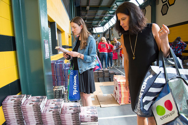 09/04/19 Wesley Bunnell | StaffrrTwenty two thousand books were donated to area educators and parents with children by ESPN and Disney on Thursday September 4, 2019 at New Britain Stadium. Jen Zaffetti, L, from Pathways Academy of Technology & Design and Jennifer Shannon from Reggio Magnet School of the Arts in Avon look through the books available.