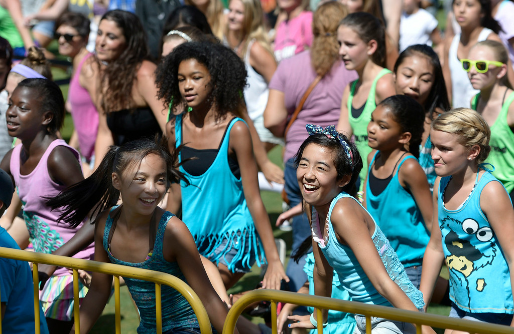 . This group of young ladies learns some dance moves during the 5th Annual National Dance Day celebration at Grand Park and The Music Center. More than 2,000 people participated in the free all-day dance extravaganza.  Los Angeles CA. 7/25/2014(Photo by John McCoy Daily News)