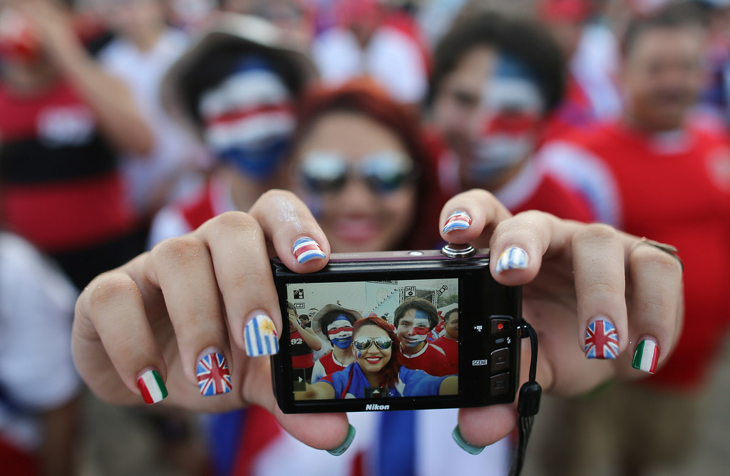 . Costa Rica soccer fans pose for a selfie before watching their team\'s World Cup round of 16 match against Greece on a live telecast inside the FIFA Fan Fest area on Copacabana beach in Rio de Janeiro, Brazil, Sunday, June 29, 2014. Costa Rica won a penalty shootout 5-3 after the match ended 1-1 following extra time. (AP Photo/Leo Correa)