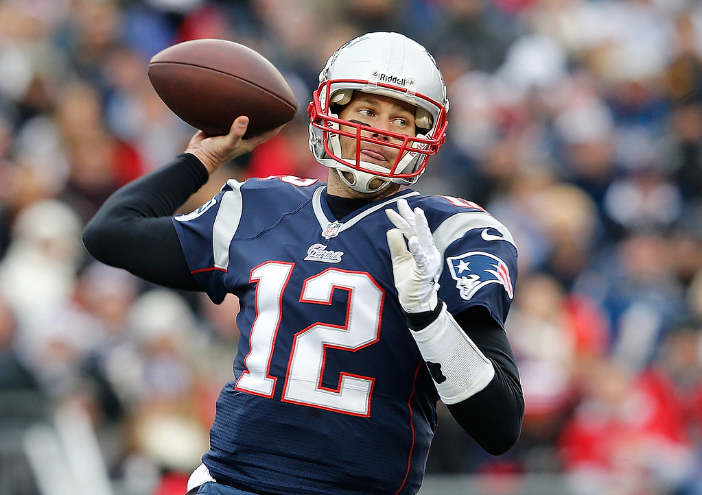 . Tom Brady #12 of the New England Patriots throws in the first half against the Cleveland Browns at Gillette Stadium on December 8, 2013 in Foxboro, Massachusetts. (Photo by Jim Rogash/Getty Images)