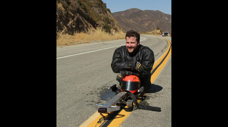 . Kevin on his custom-built luge before he takes off on a thrilling ride through the streets of LA.