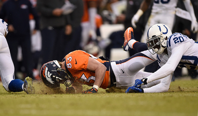 . Wes Welker (83) of the Denver Broncos hits the ground after stretching out to try to reach a pass in the second quarter. The pass was incomplete. The Denver Broncos played the Indianapolis Colts in an AFC divisional playoff game at Sports Authority Field at Mile High in Denver on January 11, 2015. (Photo by AAron Ontiveroz/The Denver Post)