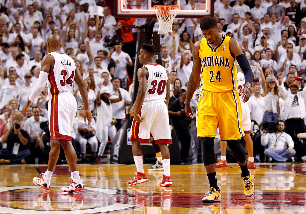 . MIAMI, FL - MAY 30:  Paul George #24 of the Indiana Pacers walks to the bench at the end of the first quarter against the Miami Heat during Game Six of the Eastern Conference Finals of the 2014 NBA Playoffs at American Airlines Arena on May 30, 2014 in Miami, Florida.  (Photo by Mike Ehrmann/Getty Images)