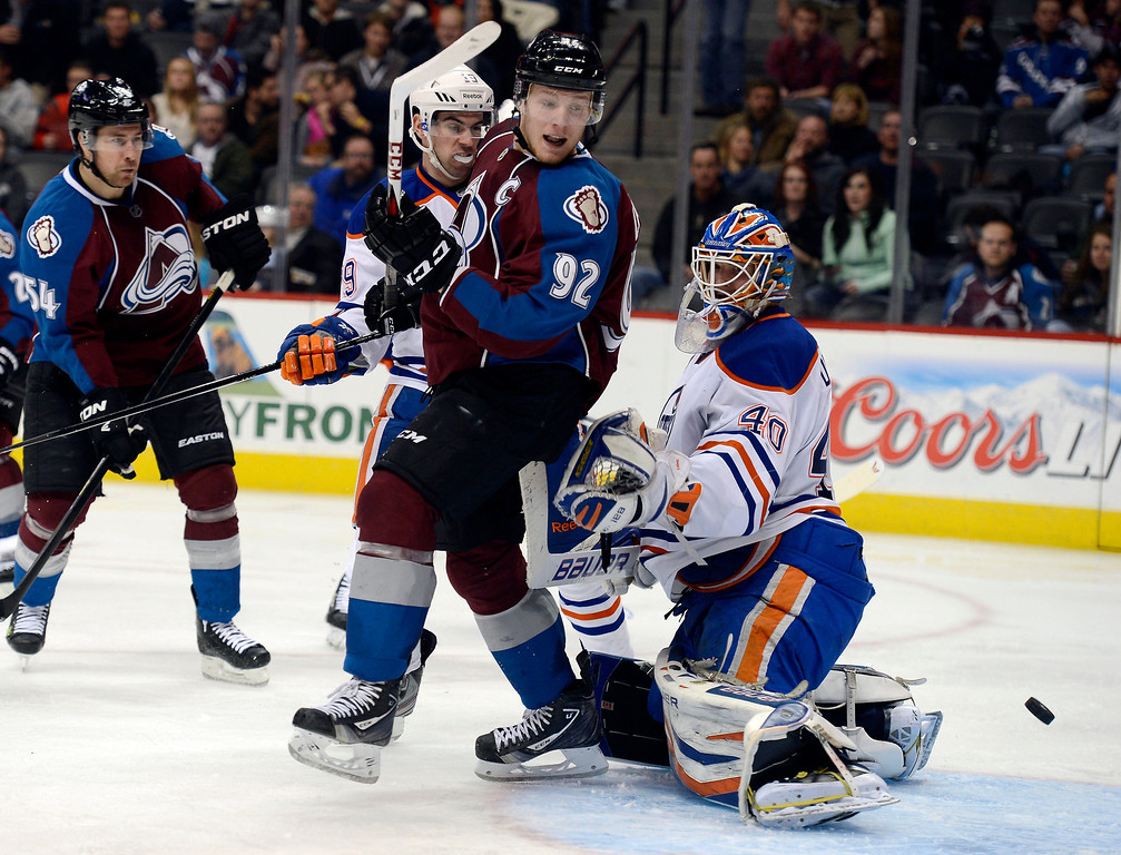. DENVER, CO. - MARCH 12: Gabriel Landeskog (92) of the Colorado Avalanche looks back past Devan Dubnyk (40) of the Edmonton Oilers at the puck as its bounces out of the net on a shot by Avalanche  Jan Hejda during the third period March 12, 2013 at Pepsi Center. The goal was waved of due to Landeskog was i the crease.(Photo By John Leyba/The Denver Post)