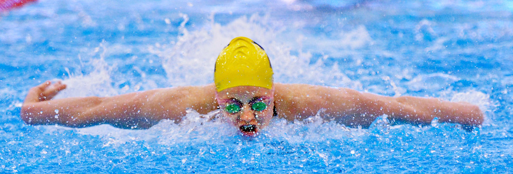 . Jeff Forman/JForman@News-Herald.com Sam Lisy, Euclid, finishes in first place in the 100 yard butterfly Saturday at the Division I sectional swim meet at Squire Institute.