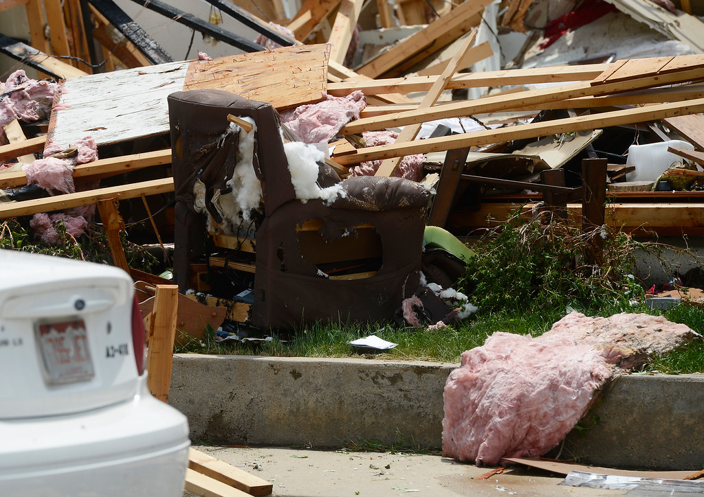 . A recliner chair is among the debris scattered around after a house explosion on the 9300 block of Ingalls Street in Westminster, Colorado, Thursday afternoon June 13, 2013.  (Photo By Andy Cross/The Denver Post)
