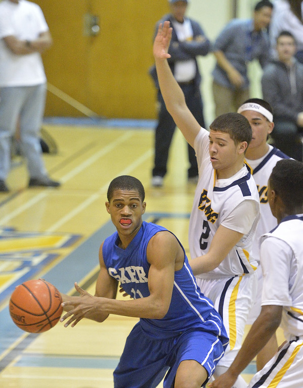 . LONG BEACH, CALIF. USA -- Gahr\'s Chudi Ibe (11) looks to pass as Millikan\'s Robert Willis Jr. (2) tries to block him during their CIF-SS Divison 1-A playoff game in Long Beach on February 15, 2013. Millikan defeated Gahr, 74 to 64. Photo by Jeff Gritchen / Los Angeles Newspaper Group
