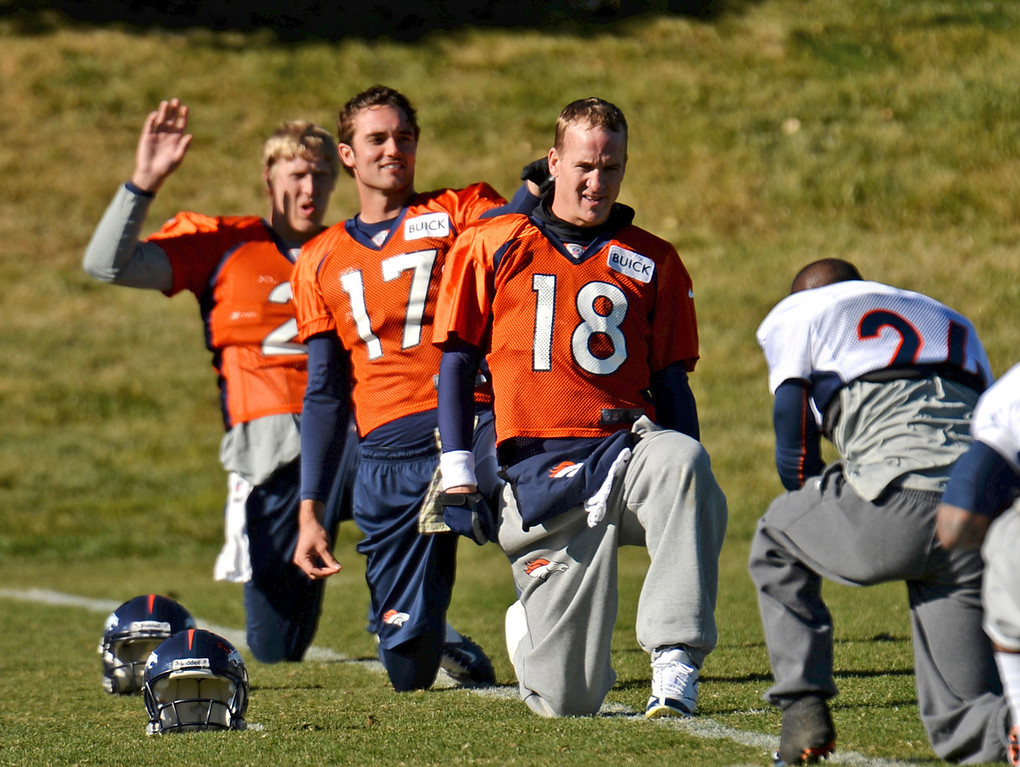 . Denver Broncos Peyton Manning (18), Brock Osweiler (17), Zac Dysert (2) are warming up for the team practice at Dove Valley practice field, Englewood, Colorado, November 15, 2013. (Photo by Hyoung Chang/The Denver Post)