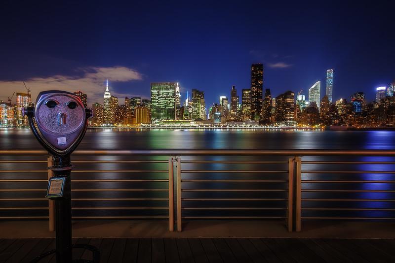 night skyline and telescope