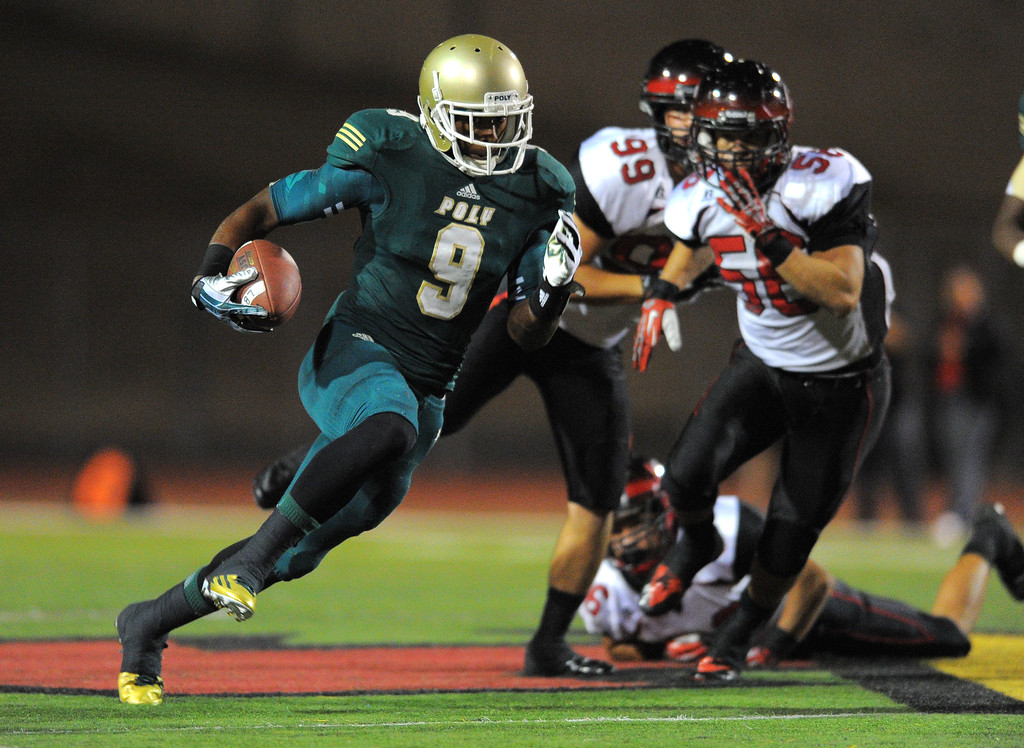 . Long Beach Poly football takes on Centennial (Corona) as part of the Mission Viejo Classic in Mission Viejo, CA on Friday, September 13, 2013. Poly\'s John Smith finds some running room. (Photo by Scott Varley, Press-Telegram)