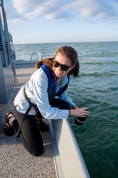 Tiffany Chin gathers a water sample to collect basic water information about the water in Corpus Christi Bay.