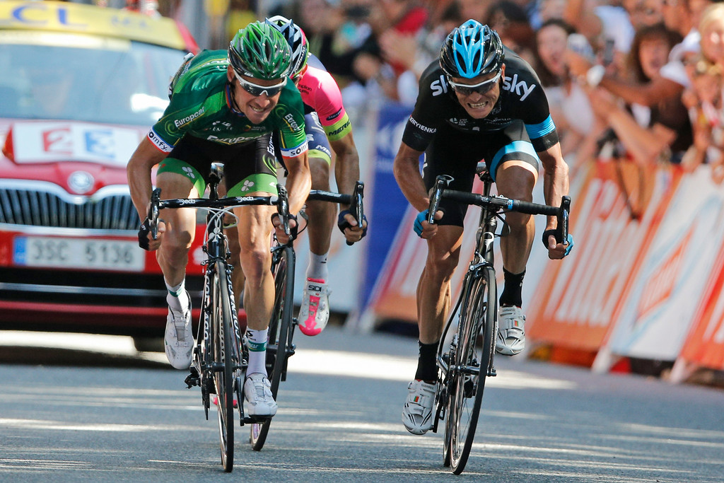 . Second place Thomas Voeckler of France, left, third place Vasil Kiryienka of Belarus, right, and fourth place Colombia\'s Jose Rodolfo Serpa, rear, sprint towards the finish line of the sixteenth stage of the Tour de France cycling race over 237.5 kilometers (147.6 miles) with start in Carcassonne and finish in Bagneres-de-Luchon, France, Tuesday, July 22, 2014. (AP Photo/Peter Dejong)