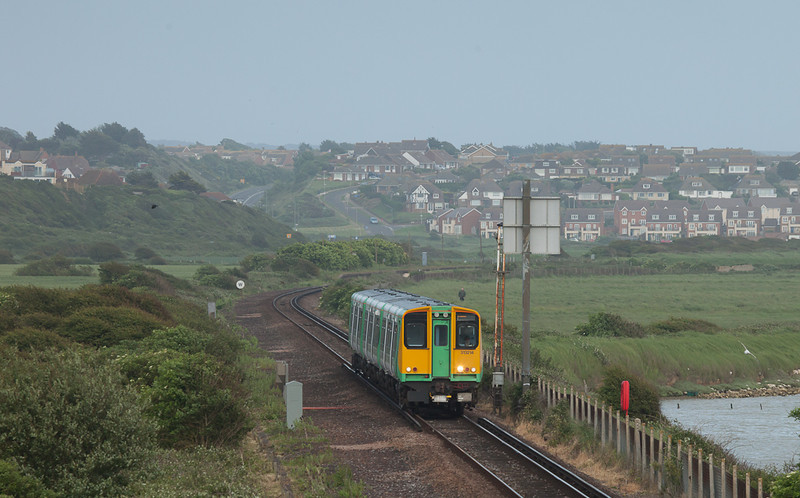 Southern 313 214 between Bishopsstone and Newhaven Harbour, Sussex.