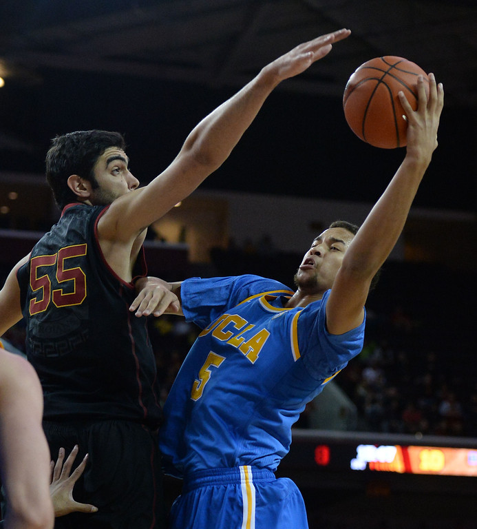 . UCLA\'s Kyle Anderson (5) drives to the basket as Southern California\'s Omar Oraby (55) defends in the first half of a PAC-12 NCAA basketball game at Galen Center in Los Angeles, Calif., on Saturday, Feb. 8, 2014. (Keith Birmingham Pasadena Star-News)