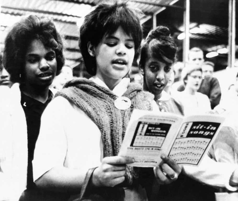 . Standing singers of sit-in songs at the New Haven bus terminal on August 28, 1963 just before their departure for Washington, D.C. to take part in the civil rights march. The songbook was furnished by the Congress of Racial Equality, with co-sponsored the Connecticut contingent of over 3,000 with the National Association for the Advancement of Colored People. (AP Photo/Bob Child)