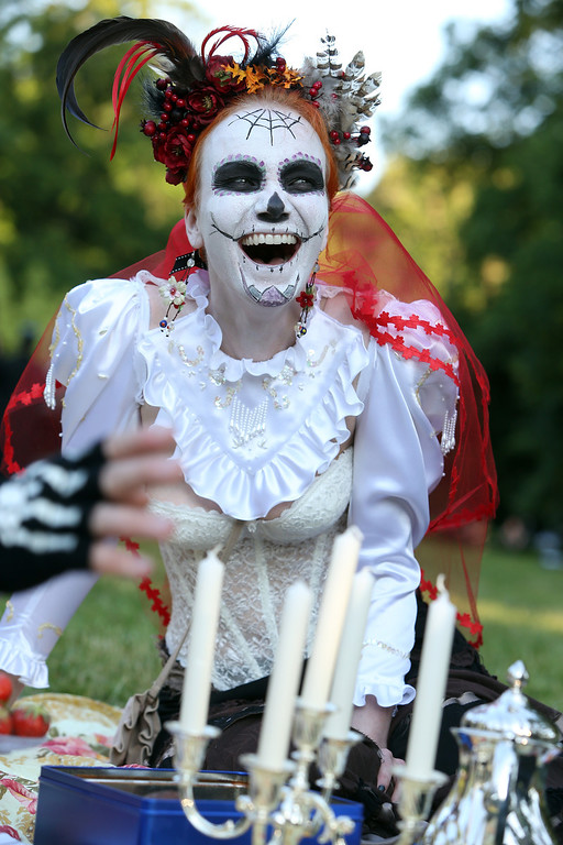 . A Gothic enthusiast attends a Victorian picnic during the annual Wave-Gotik-Treffen music festival on June 6, 2014 in Leipzig, Germany.  (Photo by Adam Berry/Getty Images)