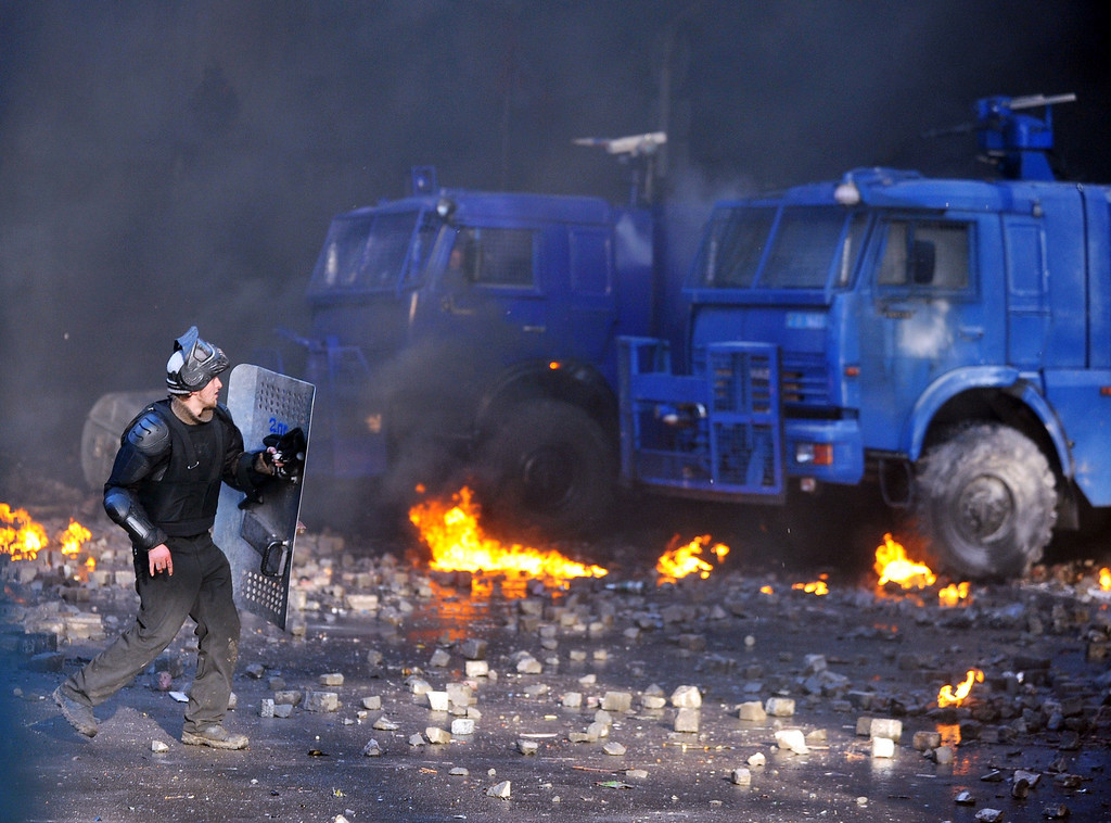 . A anti-government protester clashes with riot police in central Kiev on February 18, 2014.  AFP PHOTO/GENYA SAVILOV/AFP/Getty Images