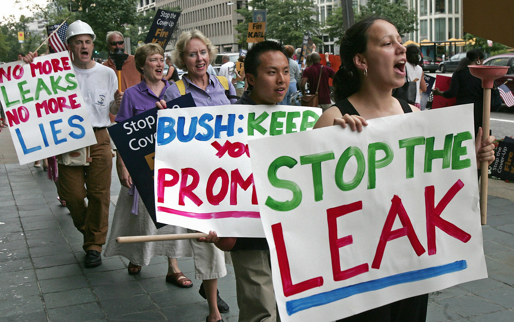 . Washington, UNITED STATES:  Protesters from MoveOn.org march in front of a building on Washington\'s Pennsylvania Avenue near the White House 19 July 2005, where White House Deputy Chief of Staff Karl Rove was attending a fundraising event, calling on US President George W. Bush to fire his top political advisor for allegedly disclosing the identiy of CIA agent Valerie Plame.    (PAUL J. RICHARDS/AFP/Getty Images)