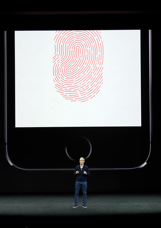 . Apple CEO Tim Cook, discusses the new iPhone 8 at the Steve Jobs Theater on the new Apple campus on Tuesday, Sept. 12, 2017, in Cupertino, Calif. (AP Photo/Marcio Jose Sanchez)