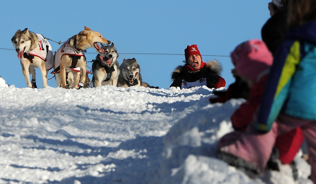 . Aliy Zirkle of Two Rivers, Alaska, greets fans at the top of Cordova Street Hill during the ceremonial start for the 2014 Iditarod Trail Sled Dog Race on Saturday, March 1, 2014, in Anchorage, Alaska. (AP Photo/The Anchorage Daily News, Erik Hill)