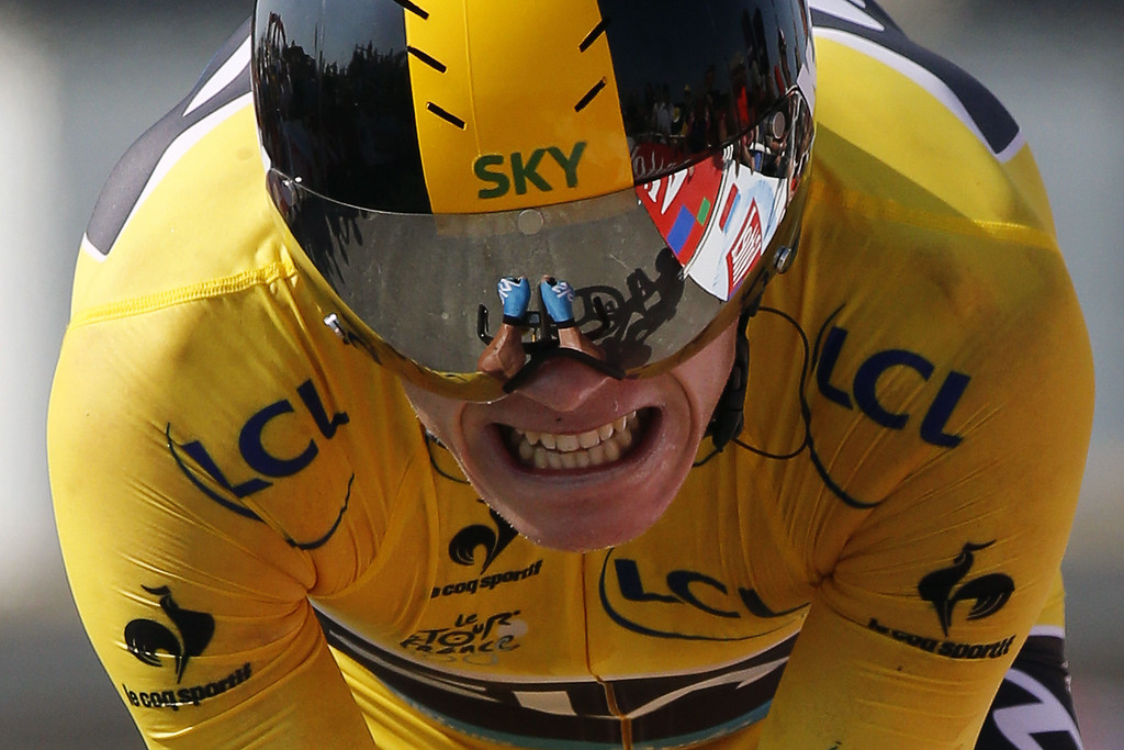 . Overall leader\'s yellow jersey Britain\'s Christopher Froome is about to cross the finish line at the end of the 33 km individual time-trial and eleventh stage of the 100th edition of the Tour de France cycling race on July 10, 2013 between Avranches and Mont-Saint-Michel, northwestern France.     PASCAL GUYOT/AFP/Getty Images