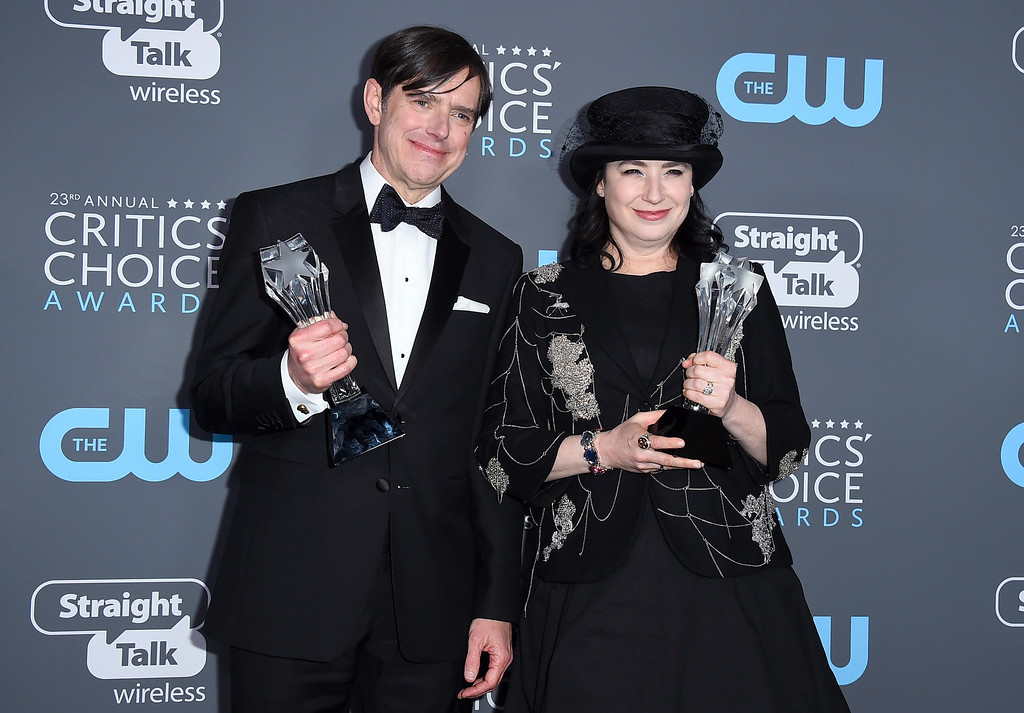 ". Daniel Palladino, left, and Amy Sherman-Palladino, winners of the award for best comedy series for ""The Marvelous Mrs. Maisel\"" pose in the press room at the 23rd annual Critics\' Choice Awards at the Barker Hangar on Thursday, Jan. 11, 2018, in Santa Monica, Calif. (Photo by Jordan Strauss/Invision/AP)"