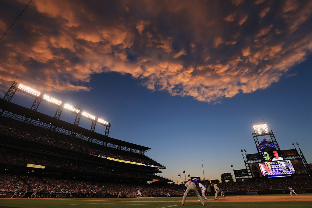 . DENVER, CO - JUNE 14:  Sunset falls over the stadium as the Philadelphia Phillies face the Colorado Rockies at Coors Field on June 14, 2013 in Denver, Colorado.  (Photo by Doug Pensinger/Getty Images)