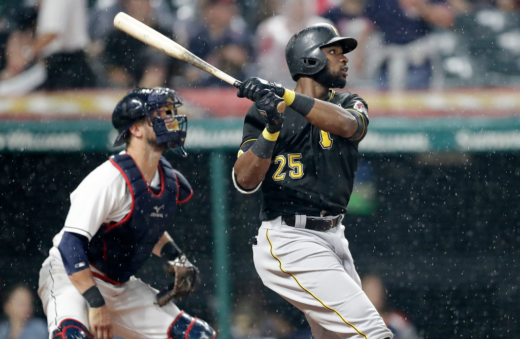 . Pittsburgh Pirates\' Gregory Polanco hits a two-run triple off Cleveland Indians starting pitcher Corey Kluber in the fourth inning of a baseball game, Monday, July 23, 2018, in Cleveland. Corey Dickerson and Starling Marte scored on the play. Indians catcher Yan Gomes watches. (AP Photo/Tony Dejak)