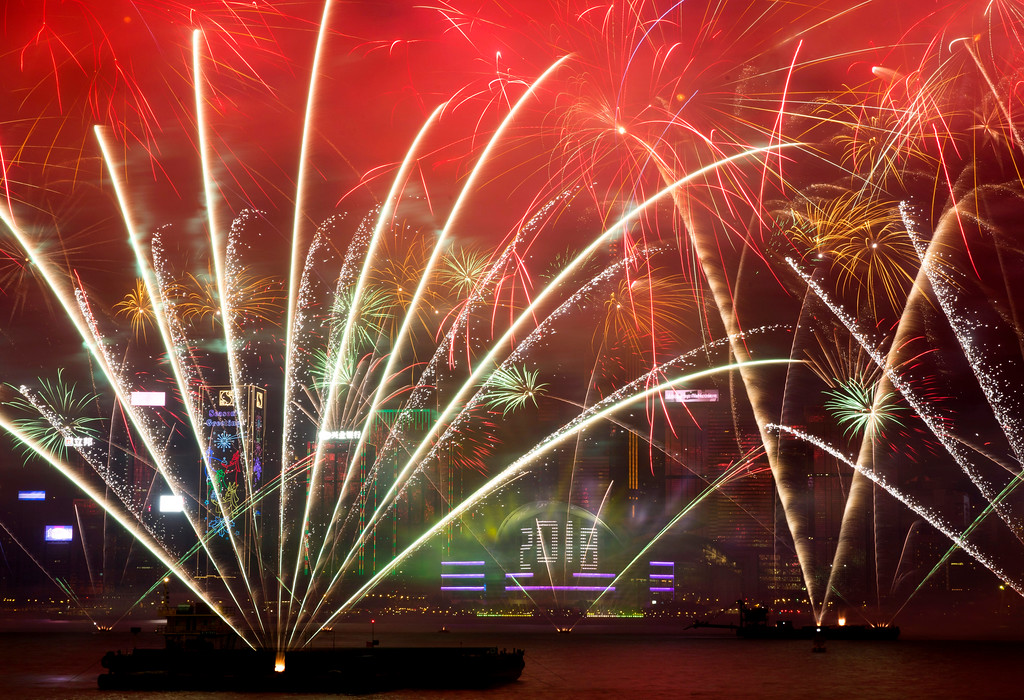 . Fireworks explode over the Victoria Harbor during New Year\'s Eve to celebrate the start of year 2018 in Hong Kong, Monday, Jan. 1, 2018. (AP Photo/Kin Cheung)