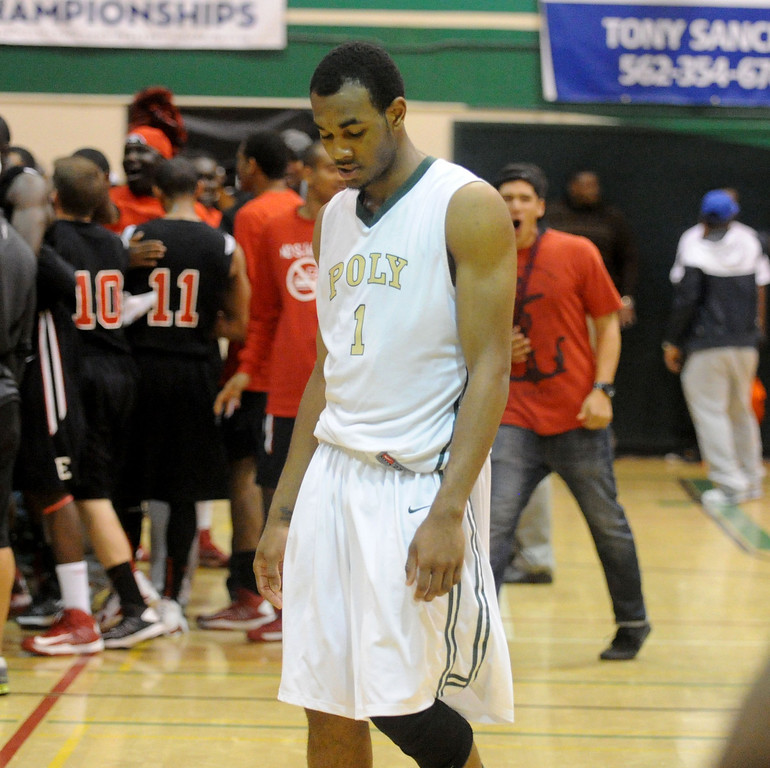 . 02-26-2012--(LANG Staff Photo by Sean Hiller)-Roschon Prince walks off court after Etiwanda beat Long Beach Poly 59-55 in overtime in Tuesday\'s  CIF Southern Section Division 1AA semifinal boys basketball game at Long Beach Poly High School.