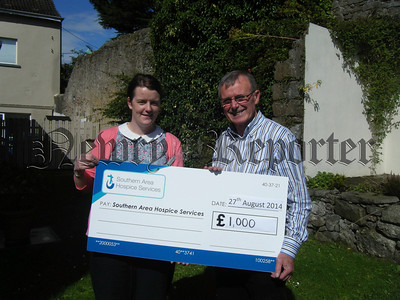 Oliver Murtagh from Lissummonn recently took on the challenge of climbing Ireland's highest peak, Carrauntoohil in Co. Kerry to mark the occasion of his 70th birthday, whilst at the same time raising funds for Southern Area Hospice Services. Oliver raised £1,000 and is pictured presenting the cheque to Anne Mac Oscar, Regional Marketing Officer for Southern Area Hospice Services. Oliver wishes to thank everyone who supported him, particularly all of his sponsors for their generous donations. R1436124