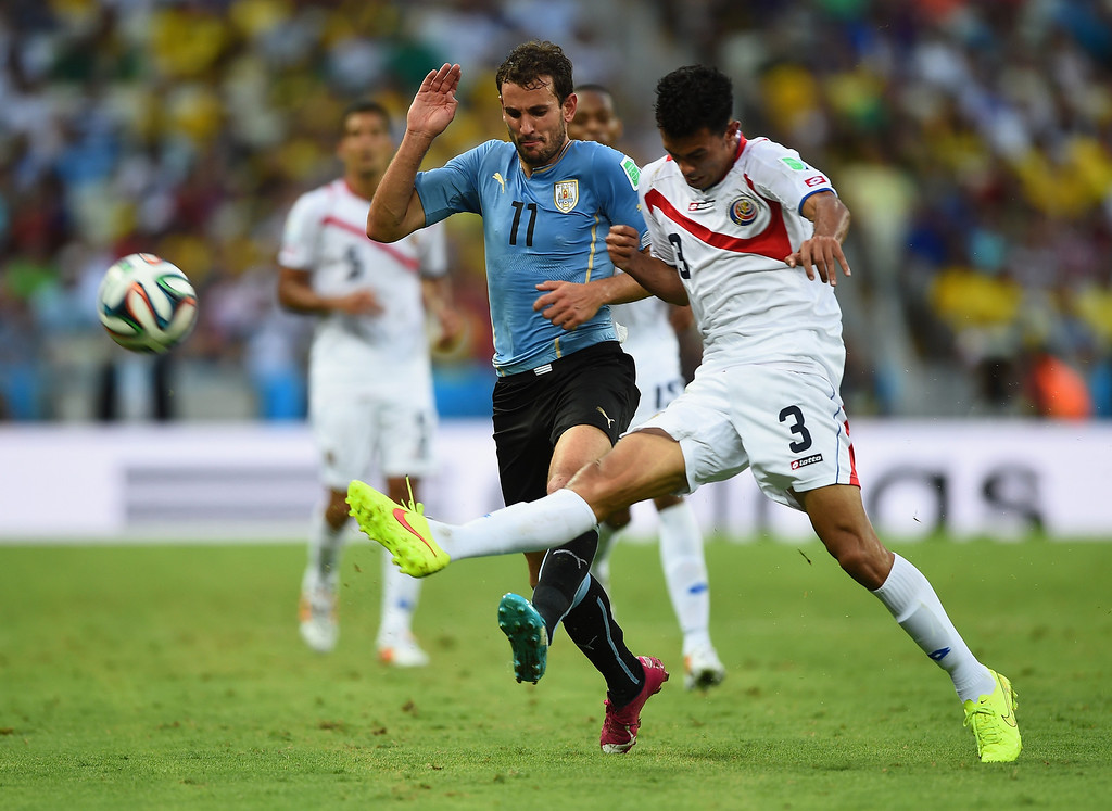 . Christian Stuani of Uruguay and Giancarlo Gonzalez of Costa Rica battle for the ball during the 2014 FIFA World Cup Brazil Group D match between Uruguay and Costa Rica at Castelao on June 14, 2014 in Fortaleza, Brazil.  (Photo by Laurence Griffiths/Getty Images)