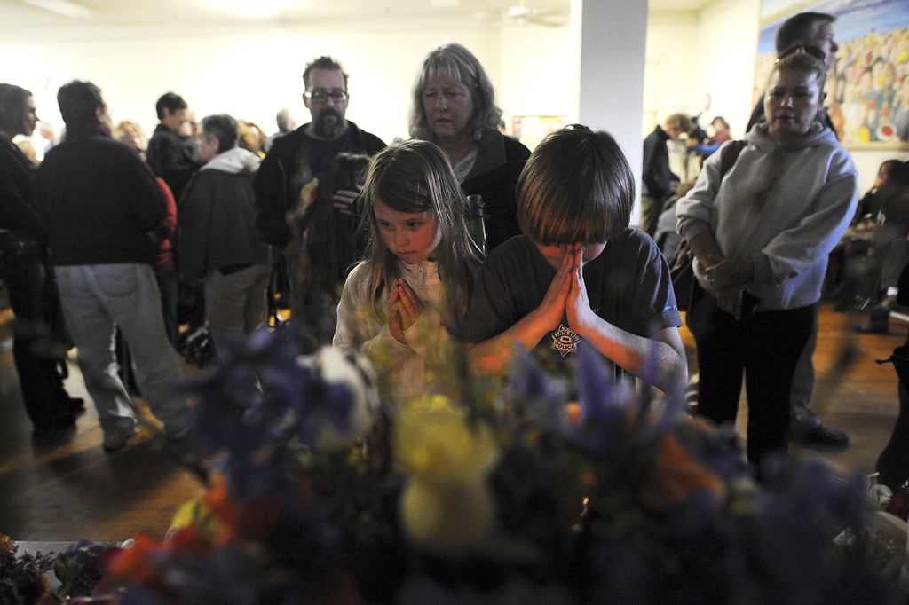 . Santa Cruz residents came en masse to the Louden Nelson Community Center Wednesday evening to pay their respects to the two Santa Cruz police officers slain in Tuesday\'s shootout (Matthew Hintz/Sentinel).