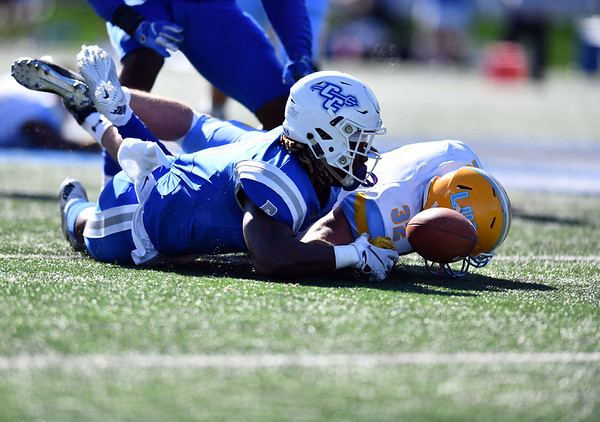 10/26/2019 Mike Orazzi | StaffrCCSU's Foday Jalloh (6) and Long Island University's Tim Marinan (32) during Saturday's football game in New Britain. r
