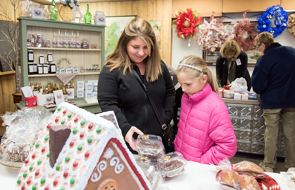 11/30/18 Wesley Bunnell | Staff The Berlin Historical Society is holding their annual craft fair Friday 11/30 and Saturday 12/1 at their museum at 305 Main St with the theme of a child's Christmas in Berlin. Renee Heckler and daughter Lauren, age 8, look over the baked goods for sale.
