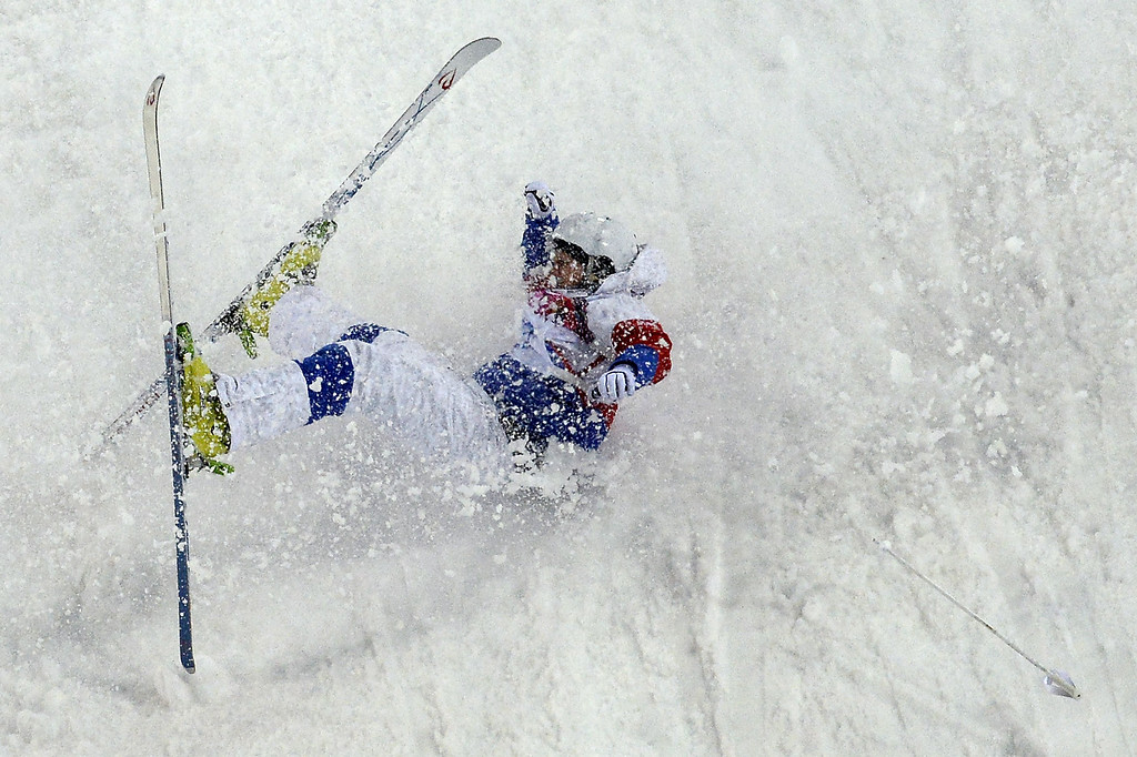 . Russia\'s Sergey Volkov falls in the Men\'s Freestyle Skiing Moguls qualifications at the Rosa Khutor Extreme Park during the Sochi Winter Olympics on February 10, 2014. AFP PHOTO / FRANCK FIFE/AFP/Getty Images