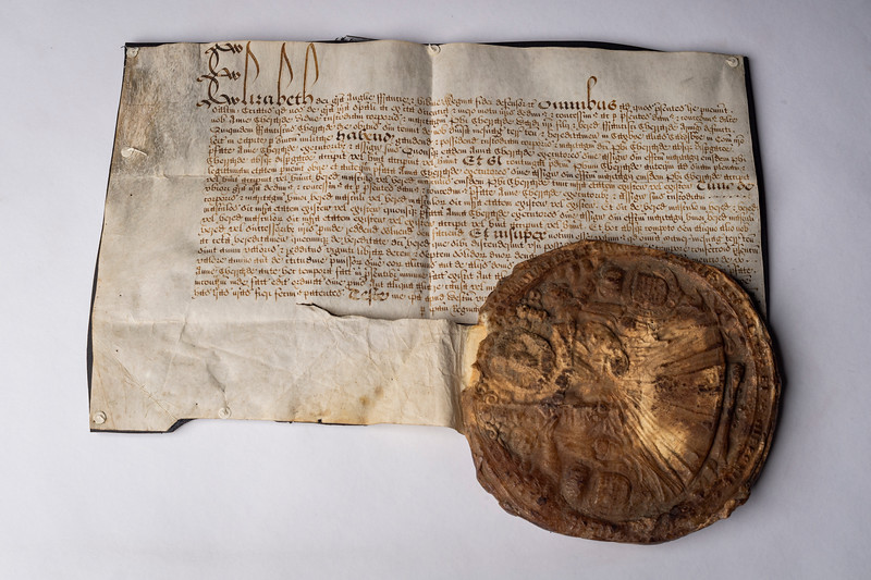 Handwritten letter from Queen Elizabeth I, along with her royal seal, ca. 1500s