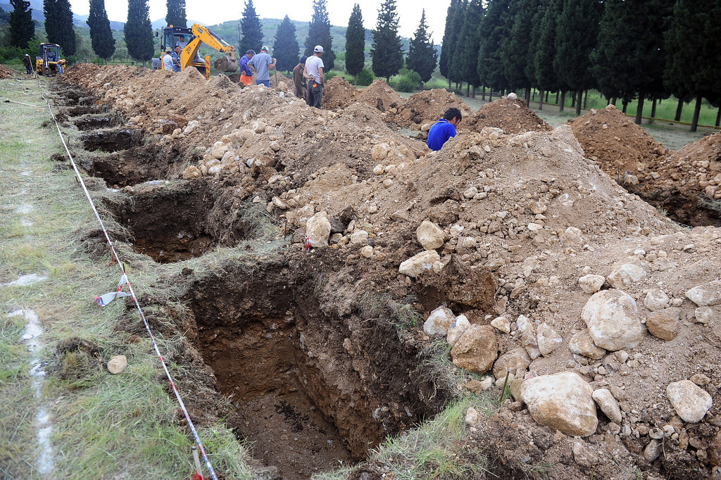 . The rows of open graves for the mine accident victims in Soma, Turkey, Wednesday, May 14, 2014. (AP Photo/Emre Tazegul)