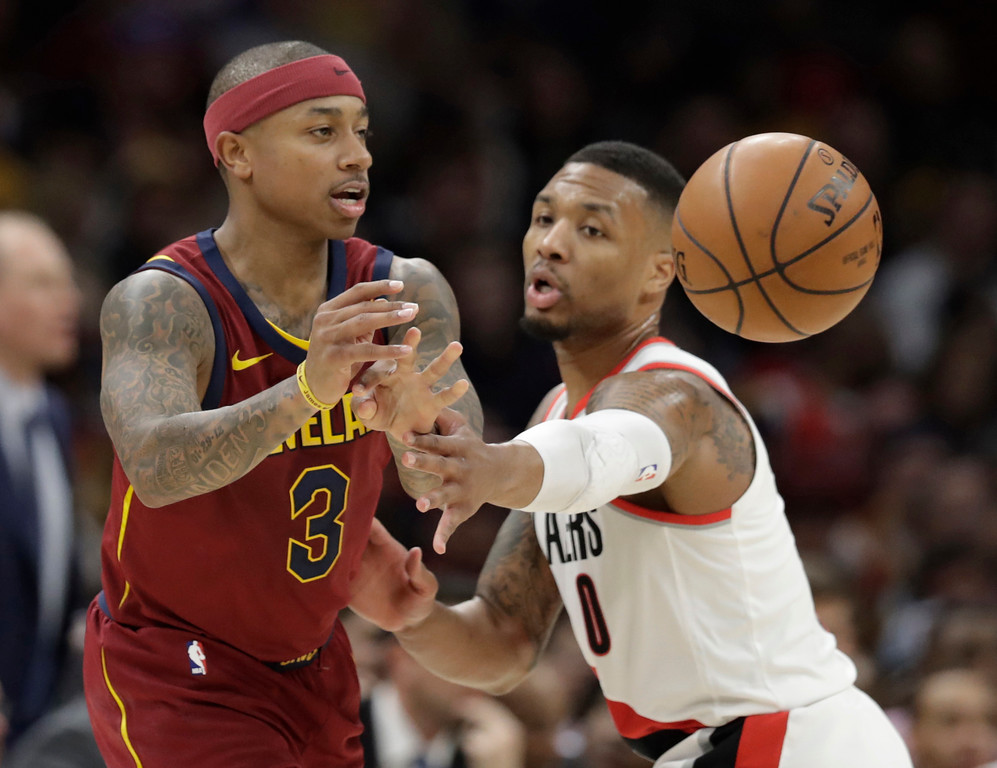 . Cleveland Cavaliers\' Isaiah Thomas (3) passes against Portland Trail Blazers\' Damian Lillard (0) in the first half of an NBA basketball game, Tuesday, Jan. 2, 2018, in Cleveland. (AP Photo/Tony Dejak)