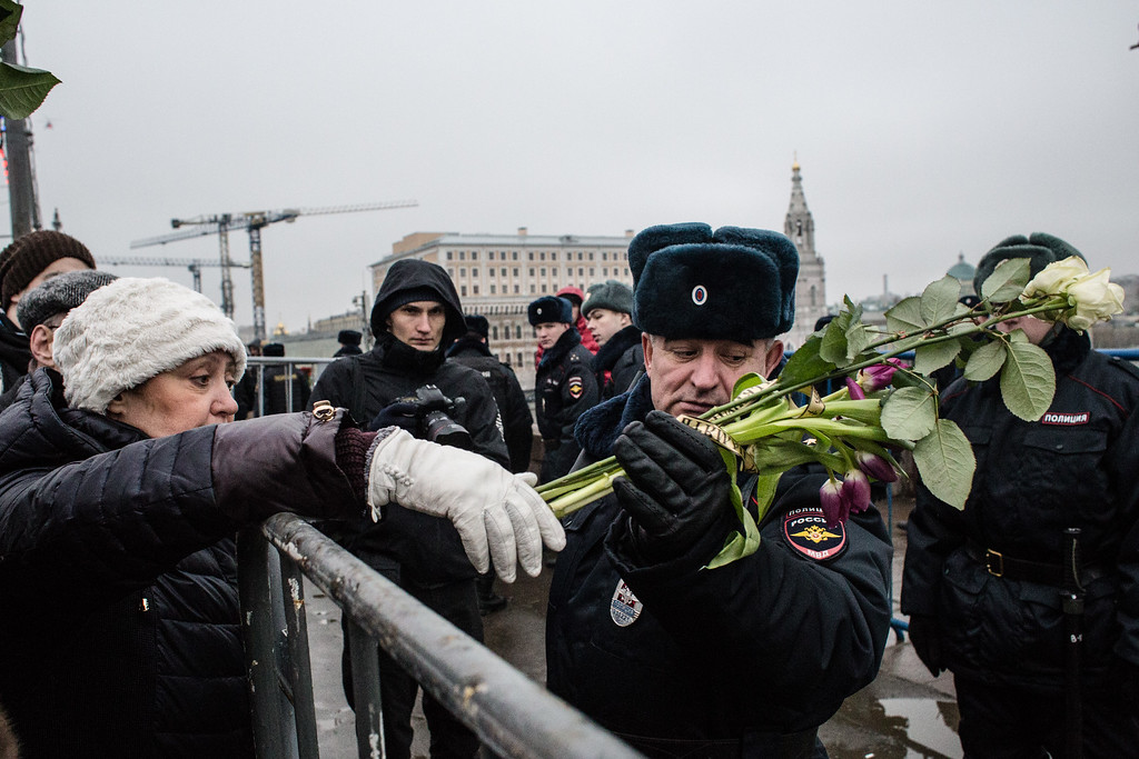 . MOSCOW, RUSSIA - MARCH 01:  People leave flowers at a march in memory of Russian opposition leader and former Deputy Prime Minister Boris Nemtsov on March 01, 2015 in central Moscow, Russia.   Nemtsov was murdered on Bolshoi Moskvoretsky bridge near St. Basil cathedral just few steps from the Kremlin on February 27.  Nemtsov, a fierce critic of President Vladimir Putin, was shot dead ahead of a major opposition rally this weekend. (Photo by Alexander Aksakov/Getty Images)