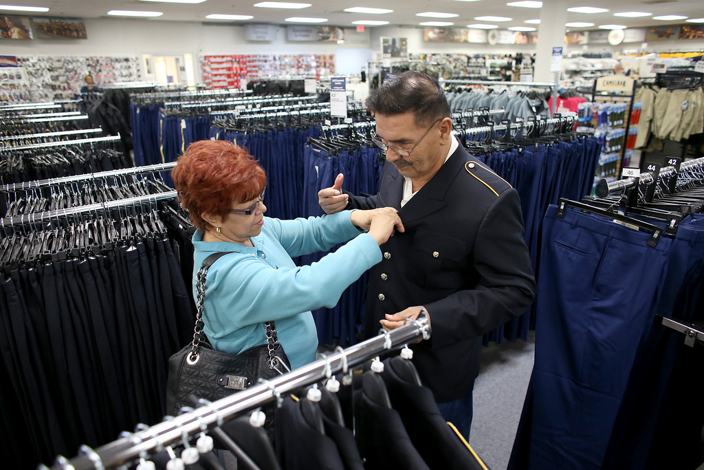 . U.S. Army Specialist Four Santiago J. Erevia with the help of his wife, Leticia Erevia, picks out a new military uniform to be worn at the White House during the Medal of Honor ceremony on March 18th for his actions while serving in the Vietnam war on March 11, 2014 in San Antonio, Texas.  (Photo by Joe Raedle/Getty Images)