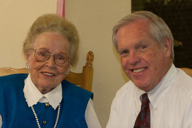 (Auntie) Janette Smith and her church Pastor.   (George)
