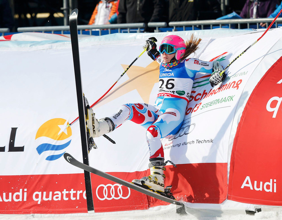 . Anne-Sophie Barthet of France rests against the barrier after crossing the finish line in her second run of the women\'s Giant Slalom race at the World Alpine Skiing Championships in Schladming February 14, 2013. REUTERS/Leonhard Foeger
