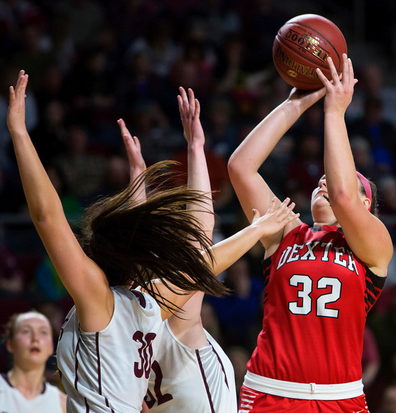 BANGOR, Maine -- 02/25/2017 -- Dexter's Megan Peach (right) puts up a shot past George Stevens Academy's Mazie Smallidge during their Class C girls basketball championship game at the Cross Insurance Center in Bangor Saturday. Ashley L. Conti | BDN