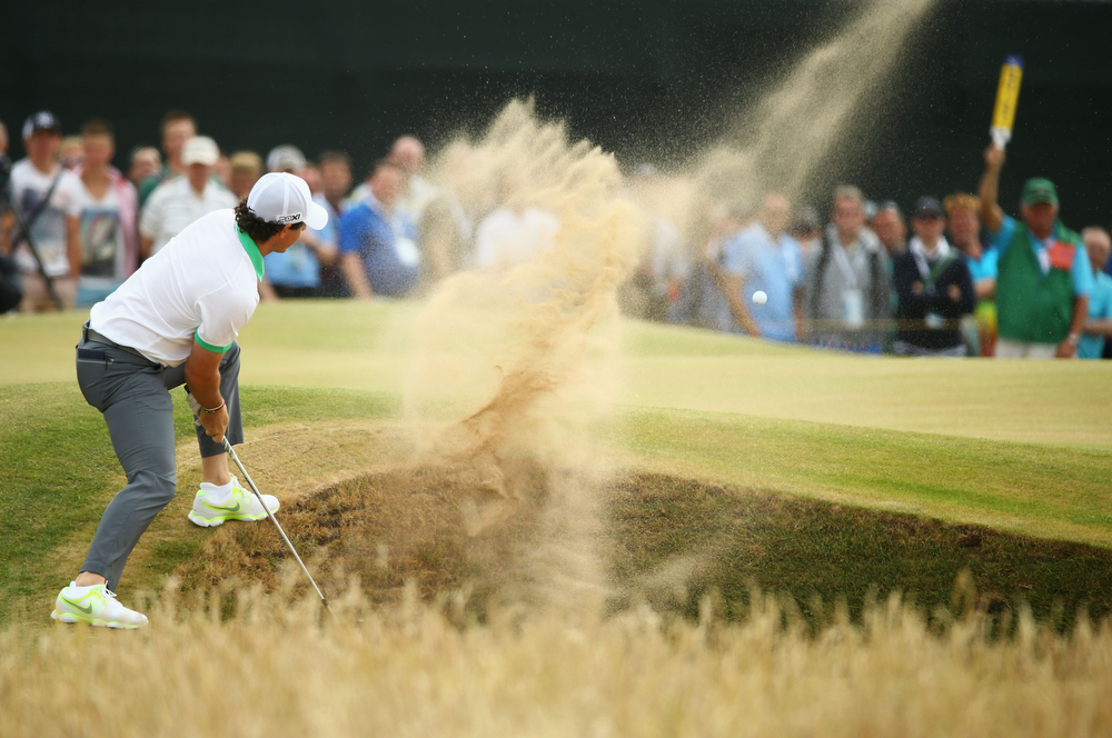 . Rory McIlroy of Northern Ireland hits out of a bunker on the 5th hole during the first round of the 142nd Open Championship at Muirfield on July 18, 2013 in Gullane, Scotland.  (Photo by Matthew Lewis/Getty Images)