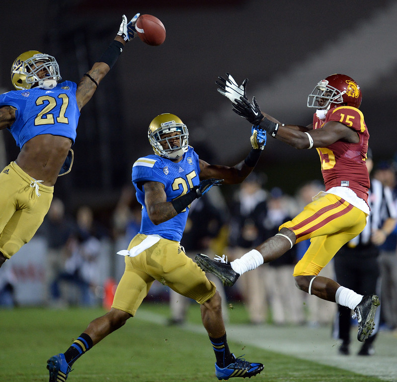 . UCLA�s Tahaan Goodman  #21 breaks up a pass intended for USC�s Nelson Agholor as Damien Thigpen #25 defends during their game at the Los Angeles Memorial Coliseum Saturday, November 30, 2013.  (Photo by Hans Gutknecht/Los Angeles Daily News)