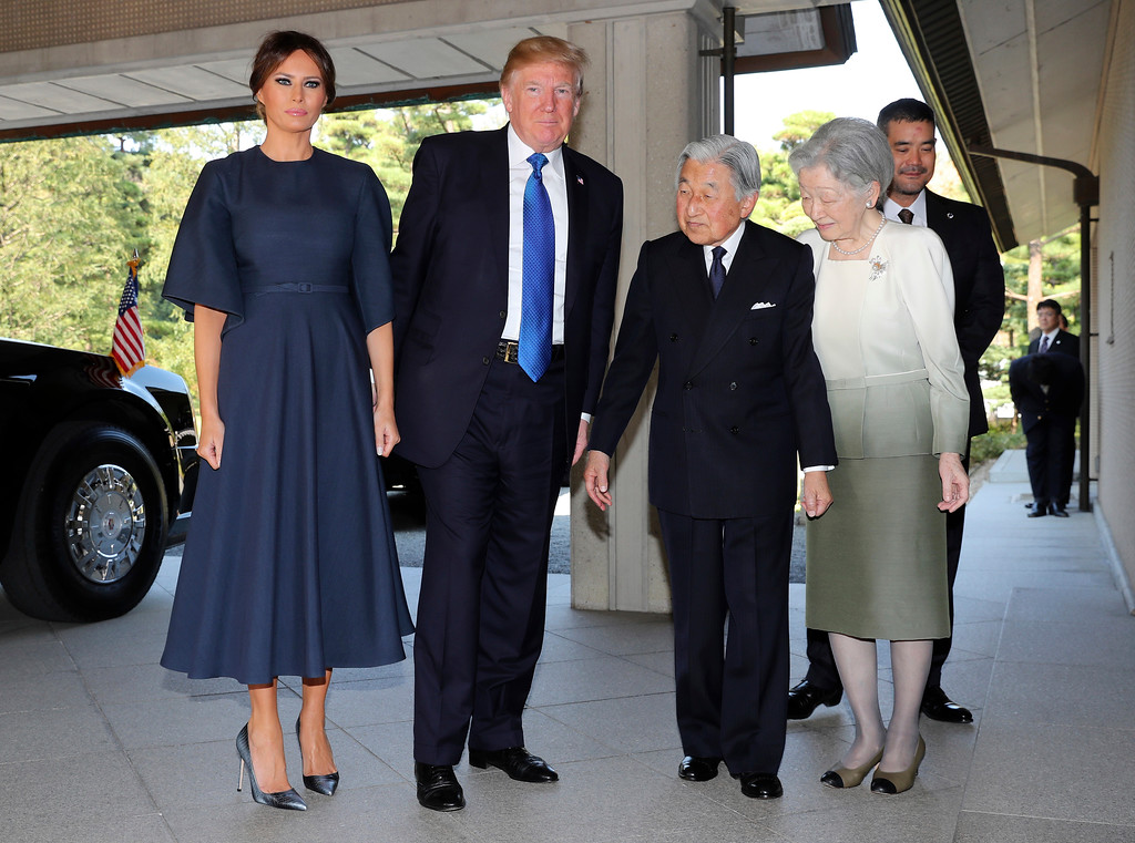 . U.S. President Donald Trump, center left, and First Lady Melania Trump, left, are welcomed by Emperor Akihito, second from right, Empress Michiko, right, upon their arrival at the Imperial Palace Monday, Nov. 6, 2017 in Tokyo. (AP Photo/Eugene Hoshiko, Pool)