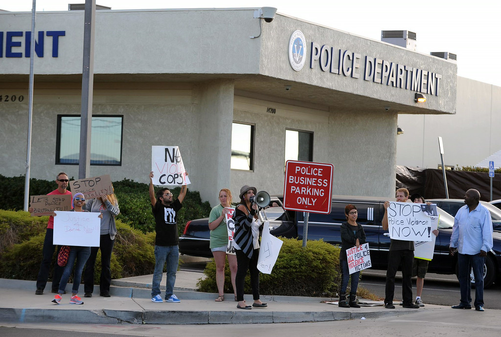 . Members of CopWatch IE and the community gather for a protest against police brutality in honor of Dante Parker on Wednesday, August 20, 2014 in Victorville, Ca.  (Photo by Micah Escamilla/The Sun)